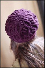 """Laurel is a fun and whimsical beret pattern with berry-like bobbles and leaf-shaped cables. The hat can be blocked for either a beret shape or a simpler beanie shape, based on the use of style-specific blocking techniques (listed at the end of the pattern). Smooth, multiple-ply yarns are the ideal choice for making the textural motifs pop. """"I love the sense of nostalgia heralded by cable & bobble patterns,"""" says designer Jared Flood. Laurel will add a playful addition to your fall and winter…"""