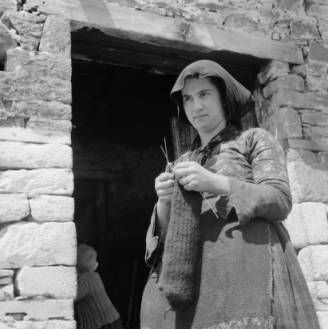 Greece, woman knitting outside door of home in Métsovon :: AGSL Digital Photo Archive - Europe
