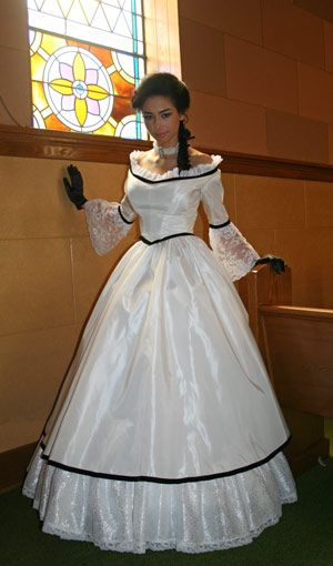 I really like the Antebellum style of this dress. I also like how it isn't completely over the top and Gone With The Wind like. I would wear this.