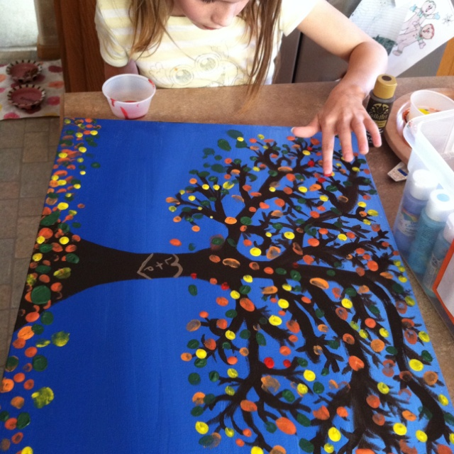 Working on a Christmas gift for Daddy. Tree painting with fingerprint leaves by all the kiddos.
