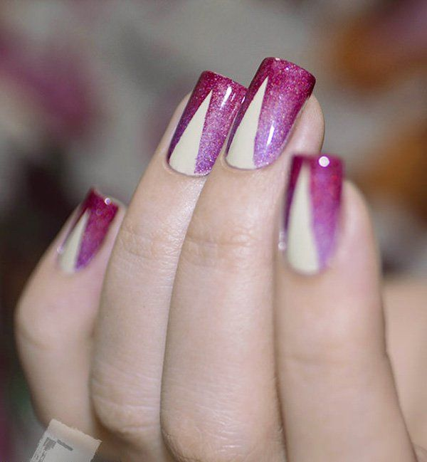 Red and violet glitter gradient winter nail art design. Gradient always gives your nails more depth, add accent by using glitter polish and a white streak in the middle of the nails.