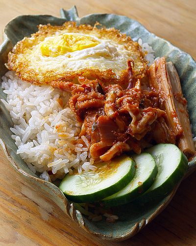 Nasi Lemak    Fried egg, sambal sotong cooked in lemon grass and cucumber on nasi lemak