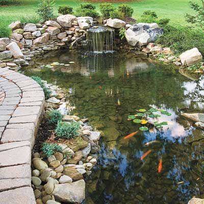 Taking cues from the existing hardscape around a home, this popular pond type has free-form edges set next to a brick, concrete, or stone patio. |  Photo: David Massengill/Cornerhouse Stock | thisoldhouse.com