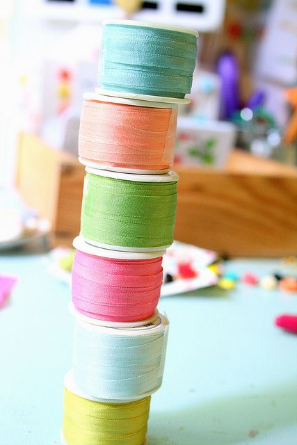 Silk ribbons.  Great idea!- store your ribbons on empty spools- no creases from cardboard!