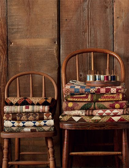 Or these stacks of quilts! The quilts were carefully folded to fit these child size chairs – sweet!