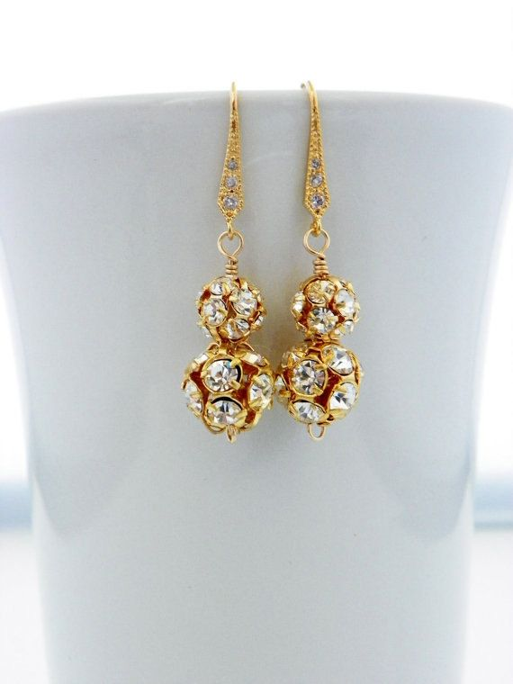 These beautiful earrings are perfect for the bride or her bridesmaids. They are made of a gold plated rhinestone ball with clear crystals