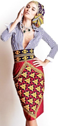 I adore the mixed styles of the african bold print pencil skirt with the pinstriped boss shirt. Stella Jean