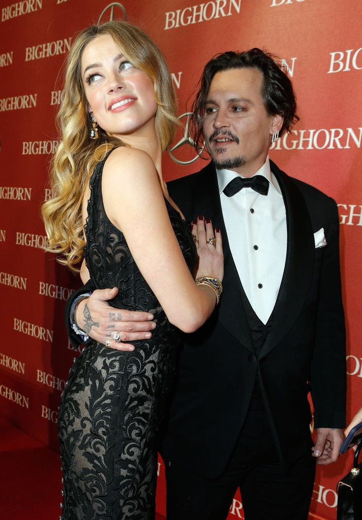You Can Feel the Heat Between Johnny Depp and Amber Heard in These Steamy Snaps