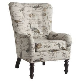 """Arm chair with vintaged academic-style upholstery and spooled legs. Made in the USA.   Product: ChairConstruction Material: Wood and fabricColor: MultiFeatures:   Turned front legsClassic style Dimensions: 41"""" H x 29.5"""" W x 35"""" D"""