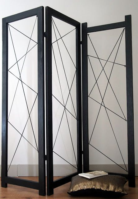 attractive black folding room divider design inspiration with brown wooden floor tile brown cushion and white book