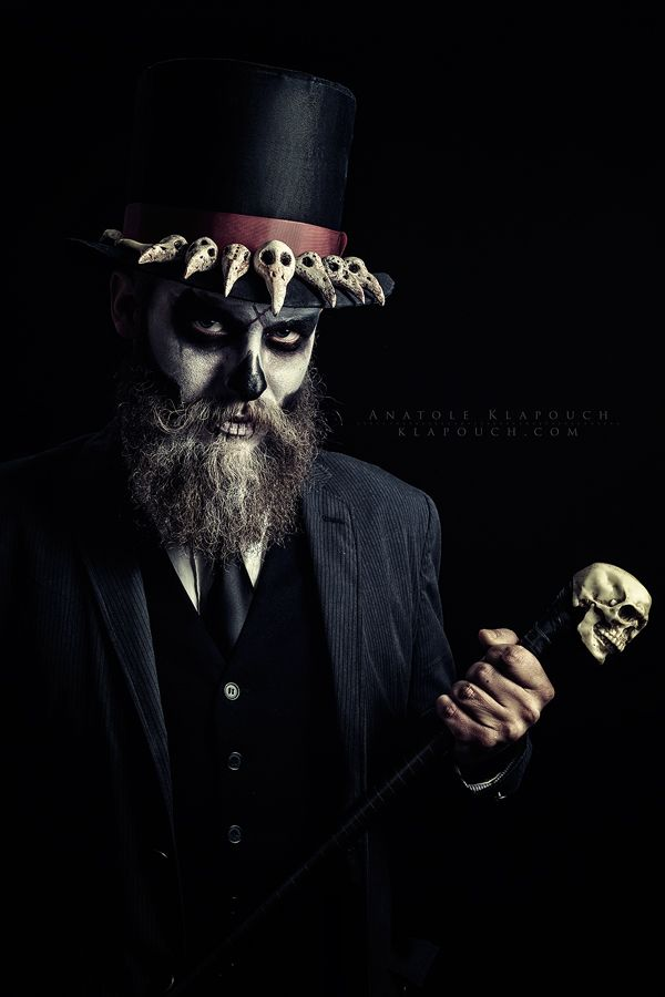 Baron Samedi by klapouch voodoo priest witch doctor shaman sorcerer wizard warlock necromancer cosplay costume LARP LRP beard armor clothes clothing fashion player character npc | Create your own roleplaying game material w/ RPG Bard: www.rpgbard.com | Writing inspiration for Dungeons and Dragons DND D&D Pathfinder PFRPG Warhammer 40k Star Wars Shadowrun Call of Cthulhu Lord of the Rings LoTR + d20 fantasy science fiction scifi horror design | Not Trusty Sword art: click artwork for source
