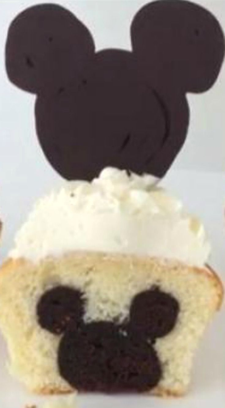 How To Make Mickey Mouse Cupcakes ~ With chocolate Mickey logo on top and Mickey logo on the inside of the cupcake too.