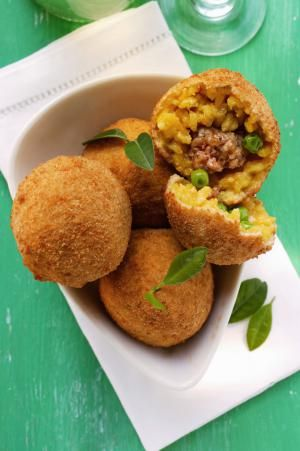 Classic Sicilian Arancini (Rice Balls Stuffed with Ragù and Peas)