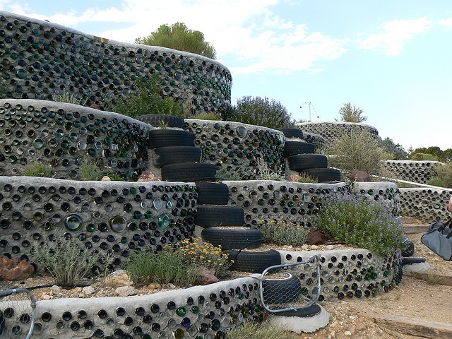 Glass wall and tire steps | Retaining wall | Pinterest ...