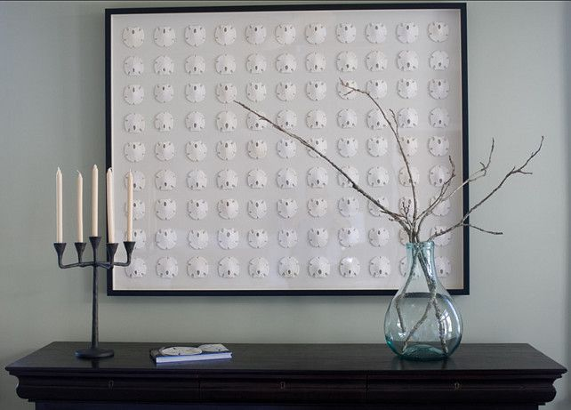 Sand Dollar Art. Although large, the simplicity of the framed sand dollars are strong enough to carry the room