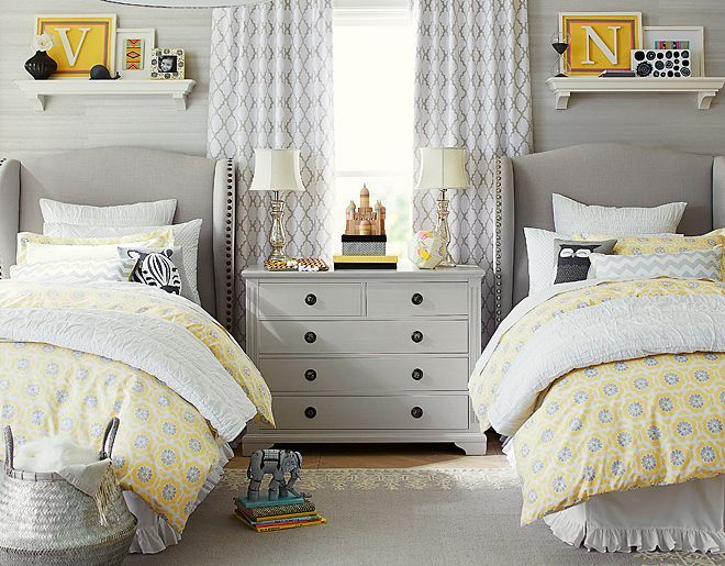shelves, grey and white, but with pink and ruffles. I like the rouching on the pillows. and the chrome lamps.