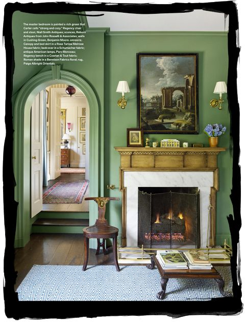 I can't even tell you how much I love these Benjamin Moore Cushing Green walls. And I love how they painted all of the trim, including the baseboards, the same color.