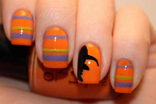 I LOVE this cheerfully-coloured Hallowe'en mani with the witch silhouette for the accent nail!  Great!