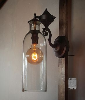 Love the old world feel of our newest sconce.  This lightly bubbled glass shade features recycled hand blown glass.