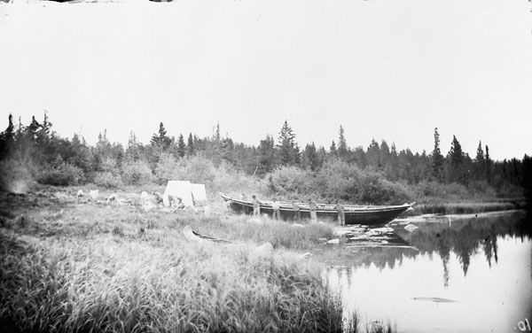 Hauling a York Boat over the Robinson Portage, Hayes River, Manitoba. 1878, Glass negative, Photograph by Dr. R. Bell. Apparently on survey, connected to the Royal Geographical Society...