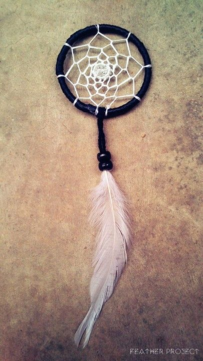 """2"""" Black wrapping White webbing with a bead in the middle. Black beads with a White feather. Length: 7""""  https://www.facebook.com/featherprojectlk/"""