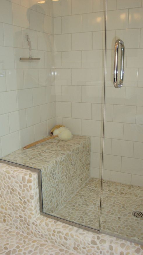 Java Tan Pebble Tile Shower Floor--love this color of pebble and grout.