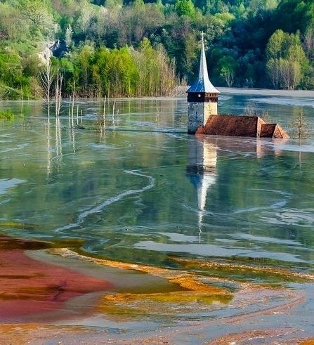 Shocking views surround this once-beautiful church & the entire village of Geamana, Romania - submerged into a toxic-waste lake after the govt began mining copper reserves in the late '70s (stunning photos).