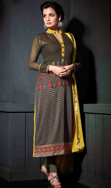 Develop a twist of urban sophistication like Bollywood diva Dia Mirza dressed in this brown, black and yellow georgette and chiffon churidar suit. The lush lace and resham works lends the most dainty look. #ElegantStraightCutDiaMirzaSuitDesign