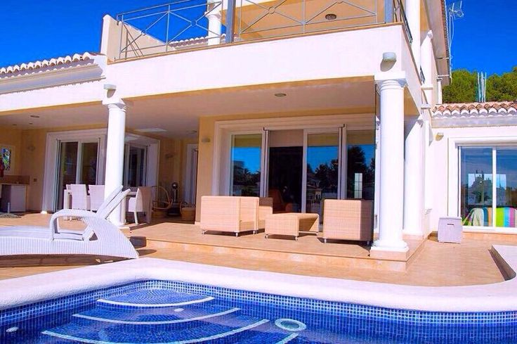 Walking through the front door of this Spanish-style estate, you see a resort style pool. (Who can resist water this blue? ) | Location: Moraira, SPAIN | Listing: https://www.properbuz.com/view-details?property-id=3-bedroom-villa-in-moraira~46934