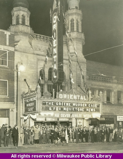 """Oriental Theater, Milwaukee, 1929. """"This crowd lined up on Oct. 16, 1929 to see The Greene Murder Case, a well-reviewed mystery starring William Powell, Jean Arthur and Florence Eldridge … Designed by local architects Gustav Dick and Alex Bauer, this $1.5 million escape from mundane cares offered the theatergoer an incredible, dreamy pastiche of Moorish, Byzantine and East Indian themes."""""""