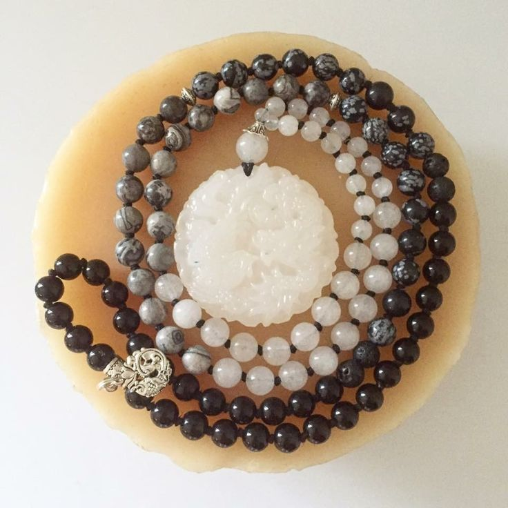 """108 bead hand-knotted ombré Mala with Snowflake Obsidian, Black Onyx, White Jade and White Picture Jasper beads. The focal is a beautifully carved Jade koi fish stone and the back end has a koi fish charm as well.  Hangs at about 21.5""""  📿Anxiety and stress relief Mala. Protests the wearer while bringing positivity, good luck and focus📿"""