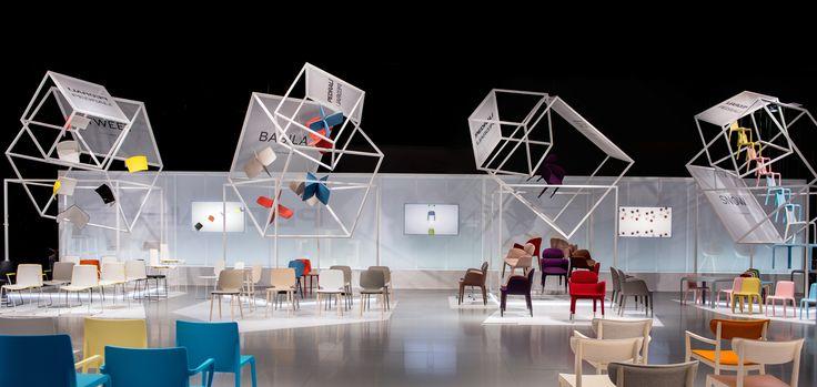 "Ten groups of ""Flying Boxes"" open upwards in different #volumes like ""matryoshka dolls"" #design #designweek #flyingboxes #pedrali #scenographicartwork #installation"