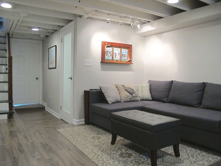 Cozy Chic Basement Reno with Exposed Painted Joists  Wood