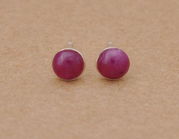 Pink Ruby and Silver Earrings. Ruby is the stone of fire and passion. Made with 5mm Ruby Cabochons and Sterling Silver Settings. Ayurvedic Birthstone for July Zodiac Birthstone for Capricorn, Aries, Cancer and Scorpio Alternative Birthstone for December *Please note as with all