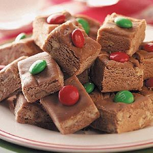 Tootsie Roll Fudge Recipe from Taste of Home -- A red or green M's candy atop each piece makes them extra jolly!  Shared by Carolyn McDill of Ohatchee, Alabama.