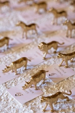 Gold animal escort cards, party animal seating cards. White sequin linen from La Tavola. Lauren & Jake's wedding featured on Carats & Cake. Planned by Simply by Tamara Nicole Arctic Club Hotel, Seattle Wedding. Photography by Alante Photography @alantephoto Makeup by Yessie Libby @YessieLibby , Cake by Honey Crumb Cake Studio @honeycrumb, Flowers by Bella Rugosa @rugosa , etc!