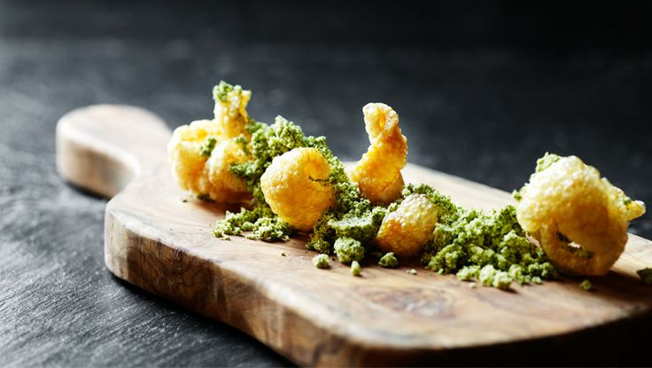Pork crackling and parsley at our Michelin star restaurant Kokkeriet, Copenhagen - Denmark.