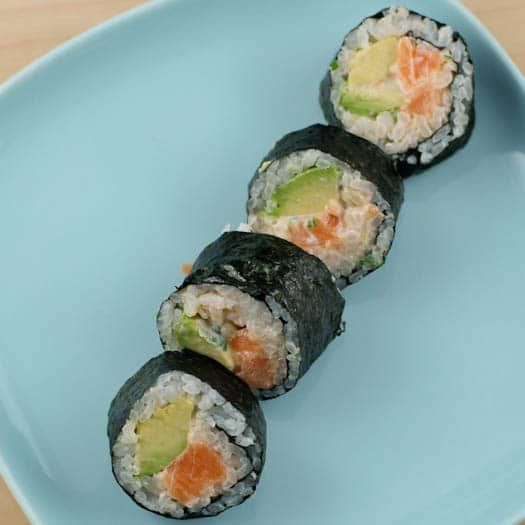 Recipe for homemade sushi made with fresh salmon, cucumber, avocado and an umami-rich spicy sauce. Making really good sushi at home is a lot easier than you'd think.