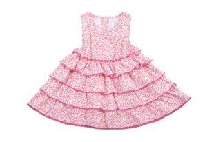 Blusa para niña, con vuelos y en tela estampada con florecitas miniatura en varios colores. Escote redondo y sin mangas.