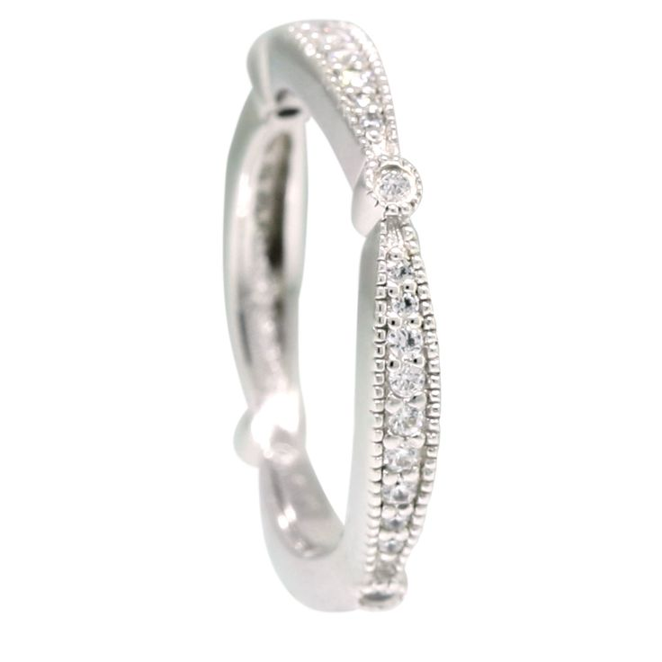 Charlotte Matching Band - The feminine curves and millgraine edges of this romantic wedding band are made to match the design of the Charlotte engagement ring. Pair these slim rings together for a shimmering set with small, subtle gaps between their curves that allow each ring special attention.   0.29 total carats of Nexus Diamonds Order additional services like a personal engraving or an appraisal for $25 each. Contact customer service      for details at ...
