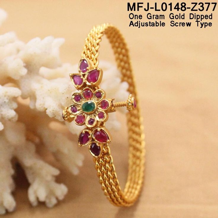 Beautiful one gram gold dipped bangle with adjustable screw type. Bangle studded with pink and green color stones. Bangle with flower design.Rs 950 plus shipping  07 November 2017