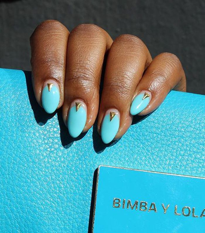 15 Nail Colors That Look Especially Amazing On Dark Skin Tones Nail Colors Almond Shape Nails Blue Stiletto Nails