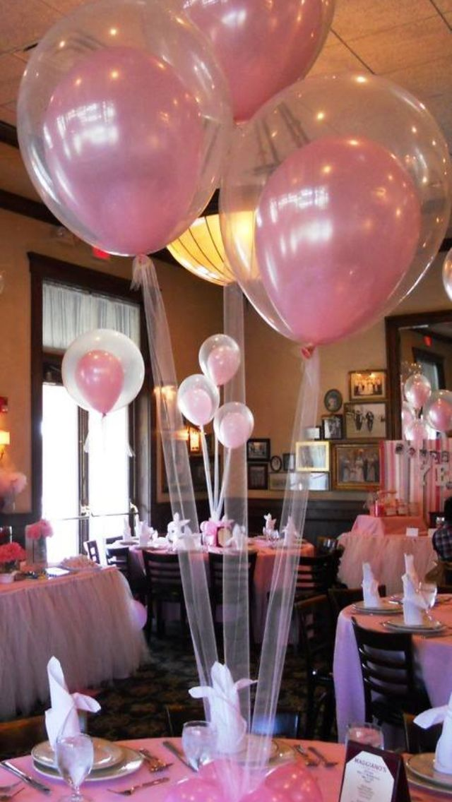 Balloons w/ tulle for baby shower. Maybe with animal print balloons inside instead?