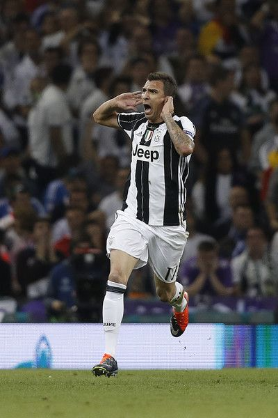 Juventus' Croatian striker Mario Mandzukic celebrates after scoring during the UEFA Champions League final football match between Juventus and Real Madrid at The Principality Stadium in Cardiff, south Wales, on June 3, 2017. / AFP PHOTO / Adrian DENNIS