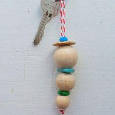 Le porte-clés avec ses trois boules en bois