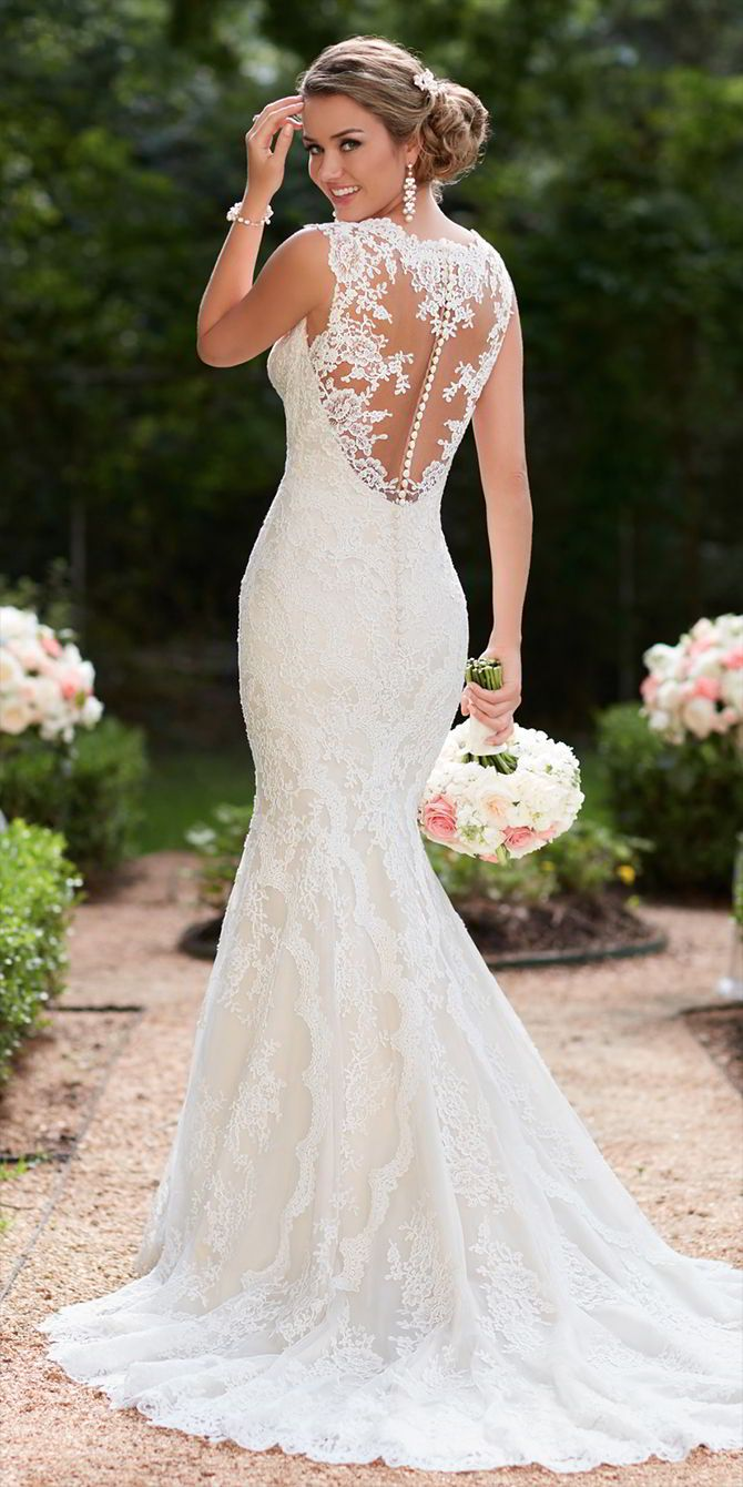 This vintage lace trumpet wedding dress by Stella York features lace and tulle over lavish satin that creates a sleek silhouette. A soft organza back plays into a substantial train with a scallop lace edge finish for a truly romantic walk down the aisle. The deep sweetheart neckline is accented by illusion lace straps that create a comfortable, yet glamorous neckline. A zipper closure is hidden under fabric-covered buttons.