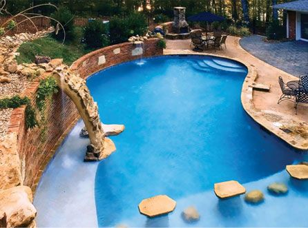 Inground pools on sloped yards pools award winning for Pool design for sloped yard