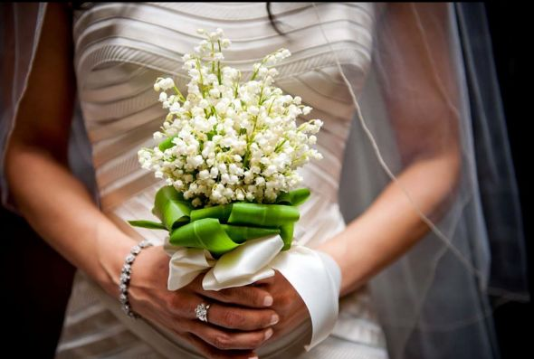 You could have a bouquet comprised of the bloom that represents the month you're getting married.  Like this Grace Kelly inspired Lily of the Valley bouquet for a May wedding.