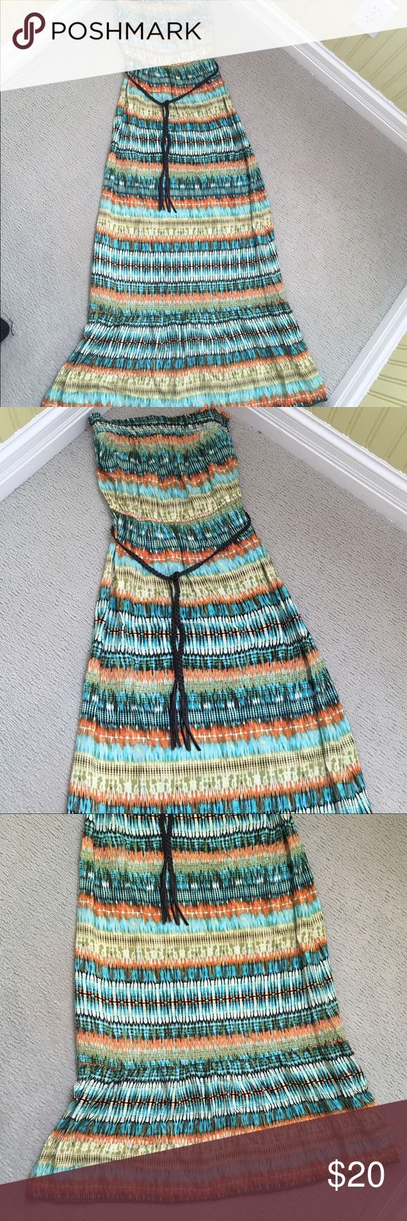 Tribal Maxi Dress This tribal maxi dress includes a leather braided belt, and has an elastic strapless band on the top. Very comfortable. Never worn, excellent condition Speechless Dresses Maxi