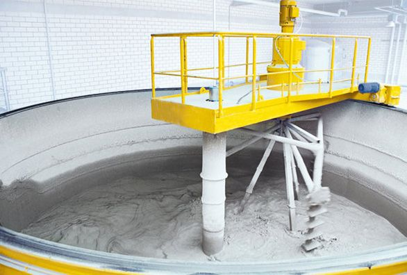 A dosing and mixing unit is used to form the correct mix to produce Autoclaved Aerated Concrete (AAC) blocks. Fly ash/sand slurry is pumped into a separate container. Once the desired weight is poured in, pumping is stopped. Similarly lime powder, cement and gypsum are poured into individual containers using screw conveyors.